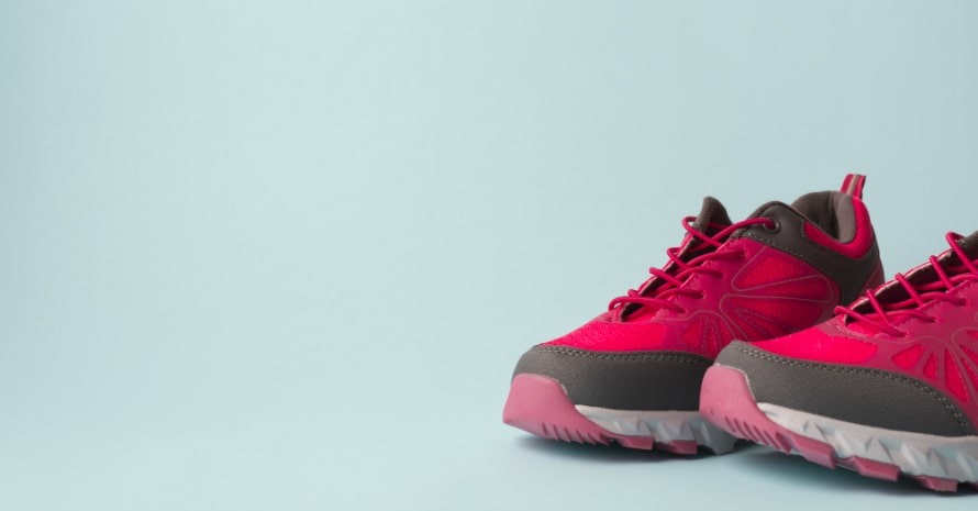 a pair of pink running shoes