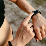 black smart watch on a hand