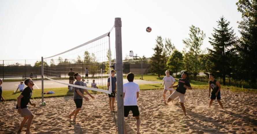 guys play beach volleyball