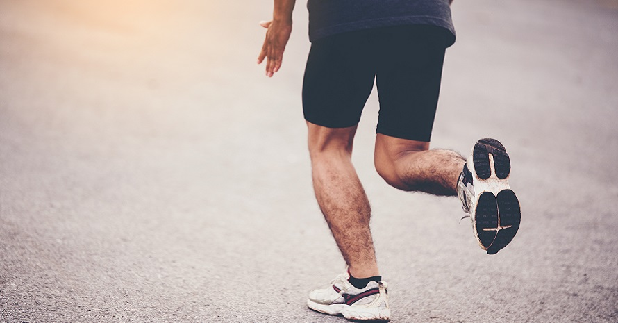 man is running in stability running shoes