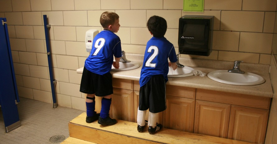 kids washing hands after football