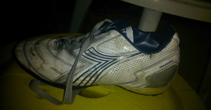 muddy soccer cleat